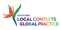 This graphic is the official logo for the Speech Pathology Australia National Conference for 2021 to be held in Darwin. The graphic in coloured text carries the words Local Contexts, Global Practice